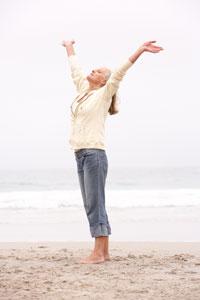 woman-reaching-toward-sky