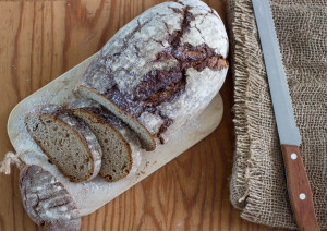 Freshly baked bread from rye flour on wooden table